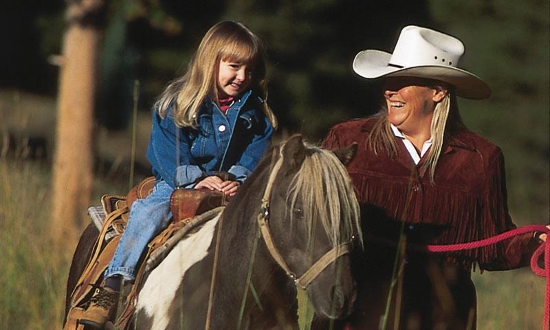 Young girl Horseback Riding at Copper Mountain