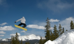 Snowboarder Jumping at Breckenridge